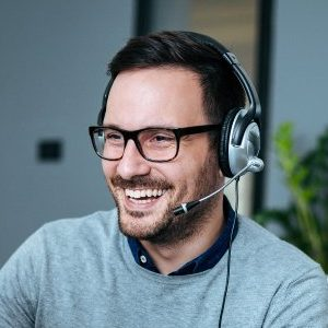 portrait-handsome-smiling-man-with-headset-working-computer
